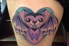 Pink and purple cartoon bat tattoo on the leg