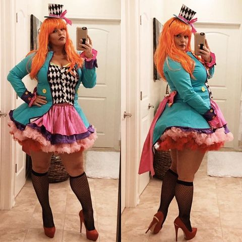 Plus size halloween costume with printed corset, purple and pink skirt, high heels and turquoise jacket