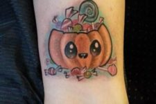 Pumpkin with candies tattoo on the ankle