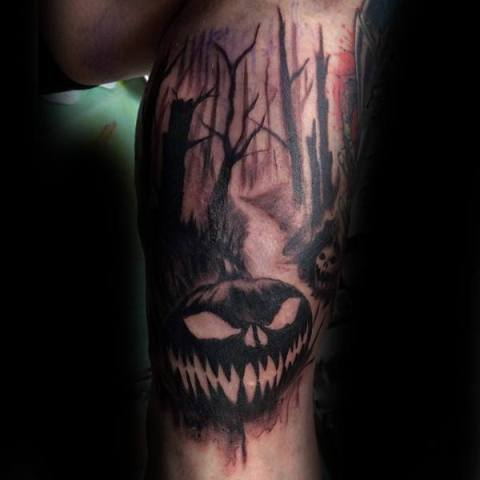 Scary forest and pumpkin tattoo
