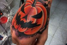 Scary pumpkin tattoo on the hand