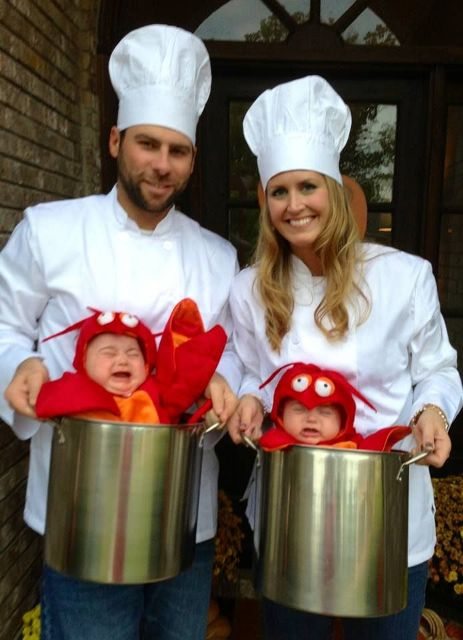 Two little boys as lobster and mom and dad as chefs