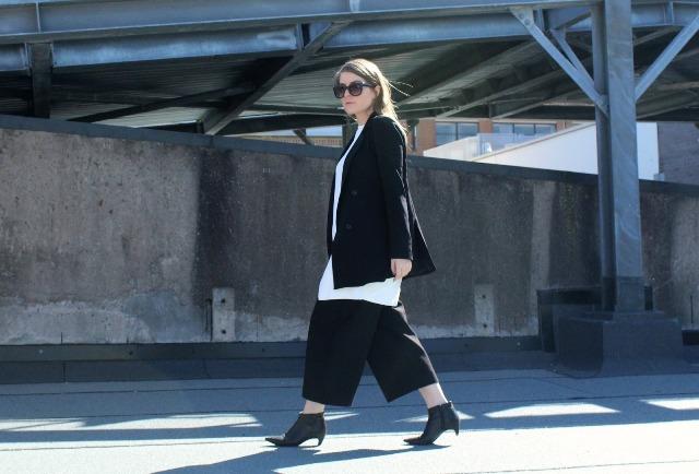 With black culottes, white oversized shirt and black jacket