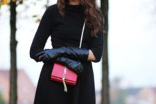 With black dress, red mini bag and hat
