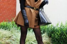 With black hat, camel coat, brown mini skirt, black turtleneck and pumps