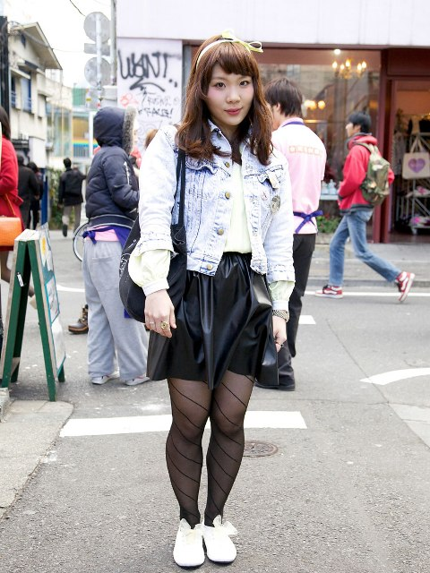 With black leather skirt, printed tights and white flats