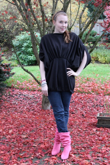 With black loose shirt and jeans