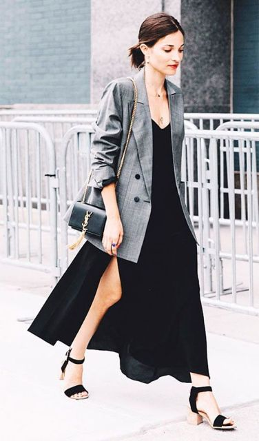 With black maxi dress, heels and mini bag