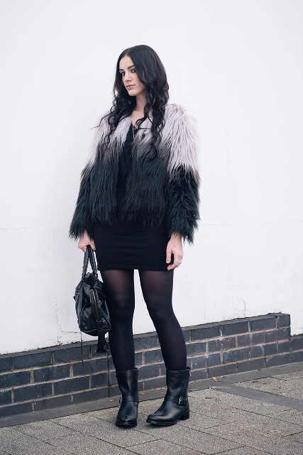 With black mini dress, black tights, flat boots and leather bag
