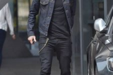 With black shirt, black jeans, brown shoes and denim jacket