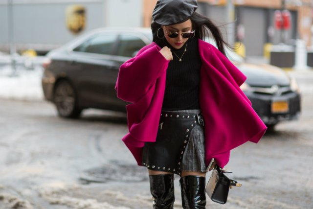 With black shirt, leather skirt, leather over the knee boots and purple coat