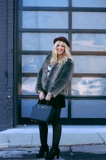With black skirt, ankle boots, black bag and fur short coat