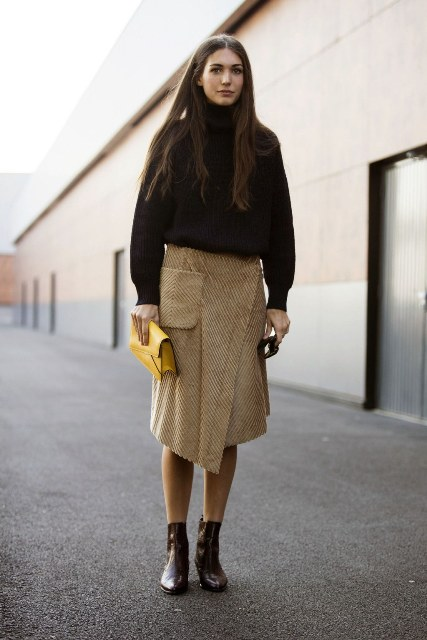 With black sweater, wrap midi skirt and yellow clutch