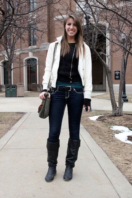 With black sweatshirt, jeans, white jacket and gray bag