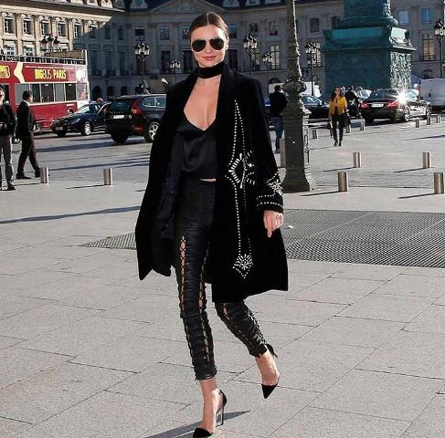 With black top, heels and embellished coat