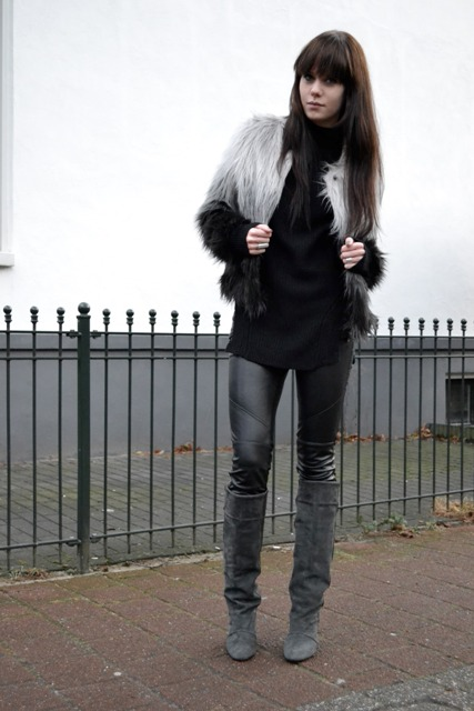 With black turtleneck, leather pants and gray high boots