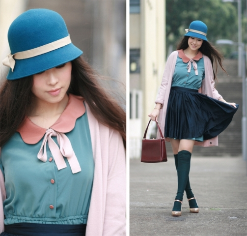 With blouse, pleated skirt, heels and brown bag