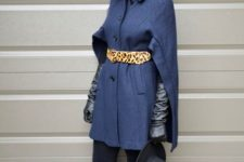 With blue coat, leopard belt, black pants, pumps and black hat