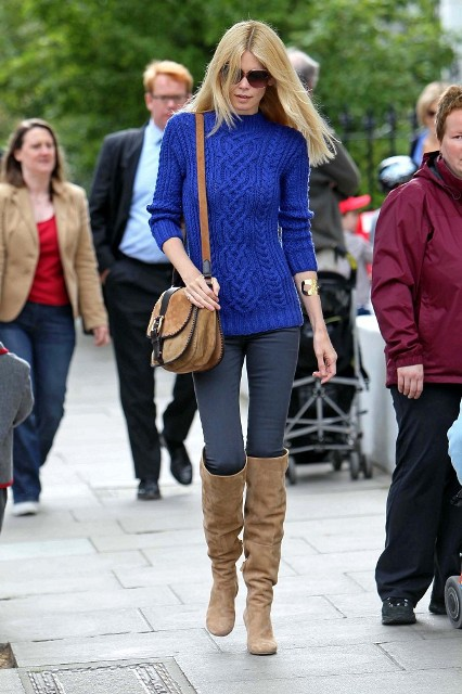 With blue sweater, gray skinny pants and brown suede bag