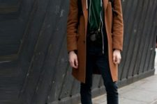 With brown coat, black pants and boots