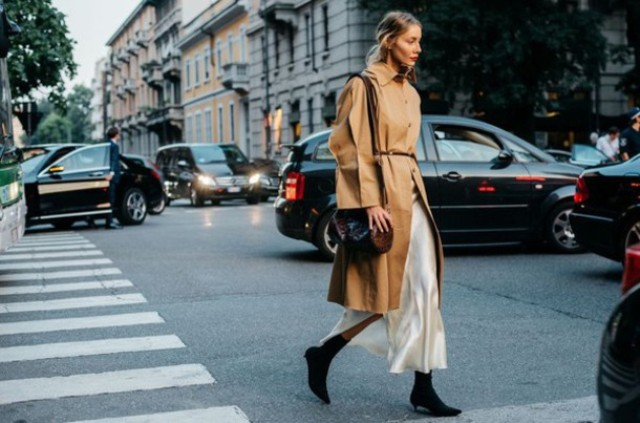 With camel coat and white dress