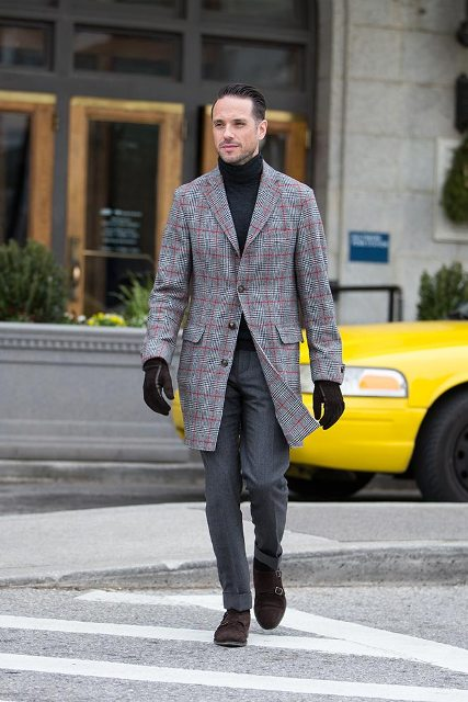 With checked coat, gray trousers and suede boots