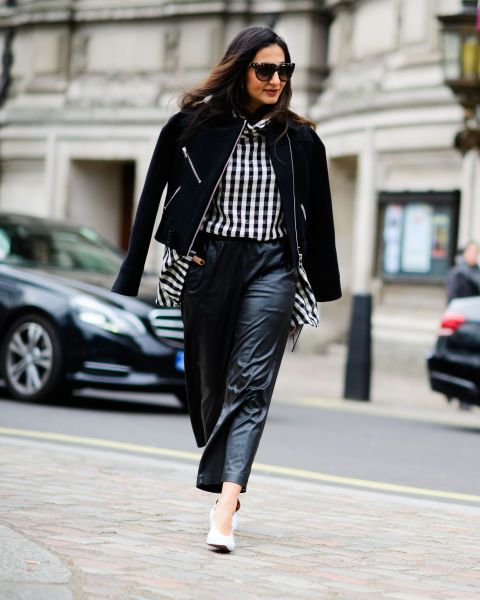With checked shirt, black jacket and white shoes