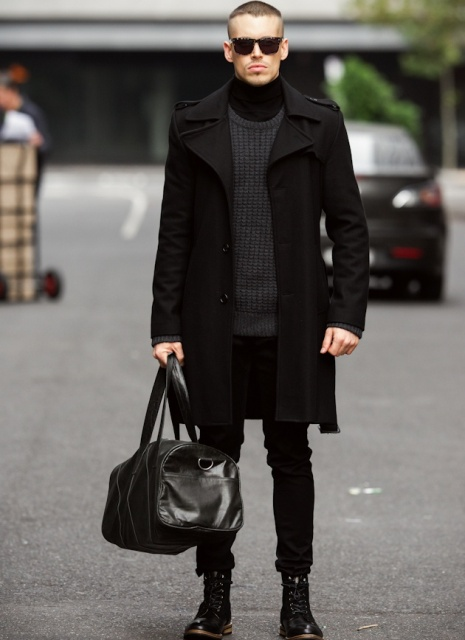 With dark gray sweater, black coat, skinny pants, mid-calf boots and big bag