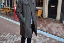With dark gray trench coat, cuffed jeans and black boots