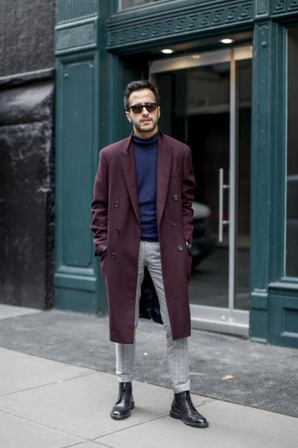 With dark purple coat, gray pants and black boots
