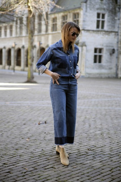 With denim shirt and beige suede boots
