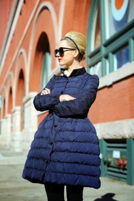 Navy puffer coat with dress and sunglasses