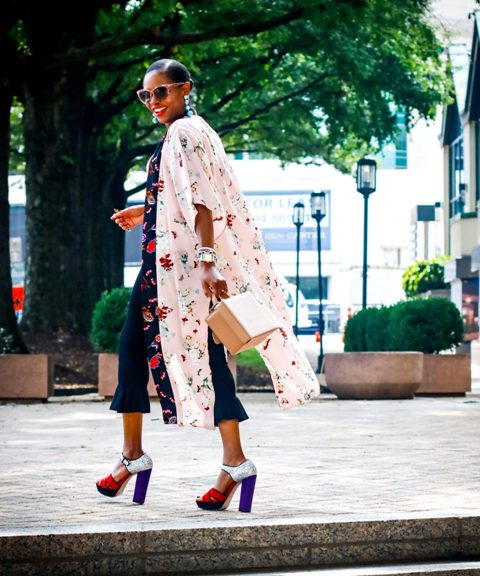 With floral airy coat, colorful heels and small bag