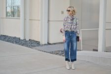 With floral blouse, white boots and clutch