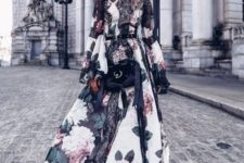 With floral maxi dress and velvet bag