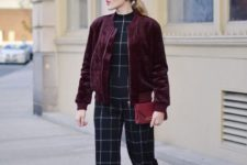 With geometric print jumpsuit, black pumps and purple clutch