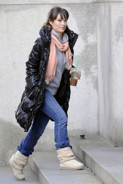 With gray hoodie, light pink scarf, jeans and white boots