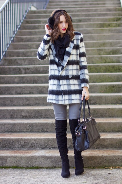 With gray pants, black high boots, leather bag and black scarf