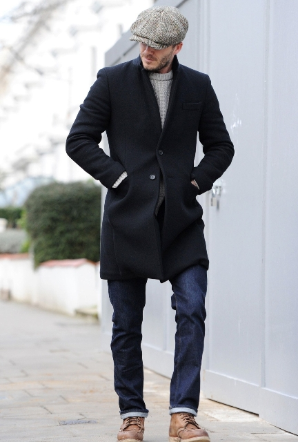 With gray sweater, black coat, jeans and brown boots