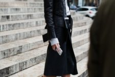 With gray turtleneck, midi skirt and leather jacket