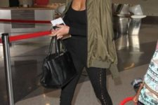 With green army jacket, ankle boots and bag