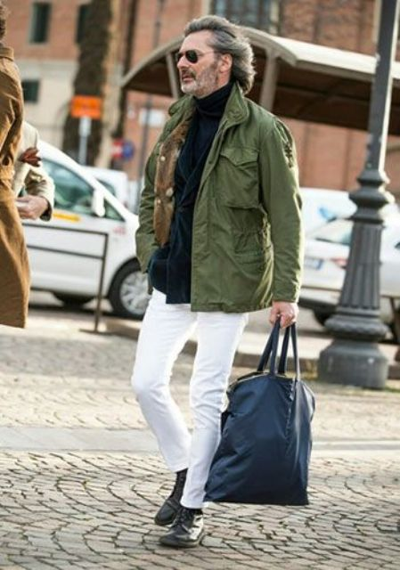 With green jacket, white pants, blue tote and black boots