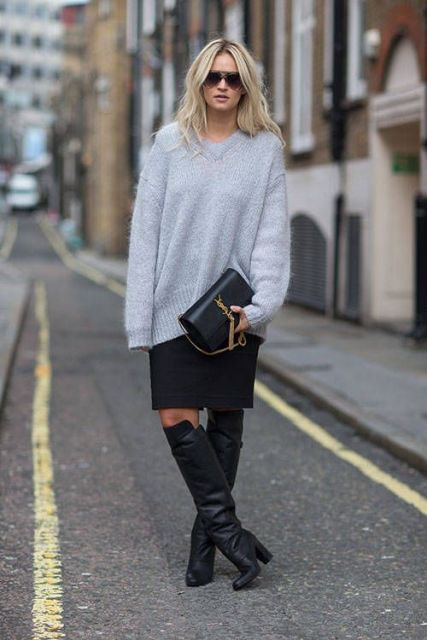 With knee length skirt, gray loose sweater and clutch