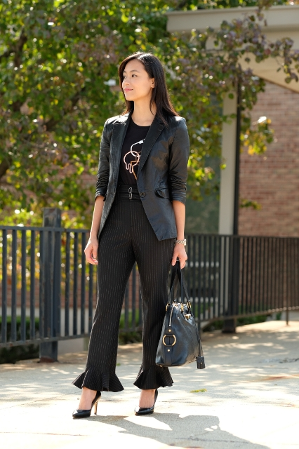 With leather blazer, black pumps and bag