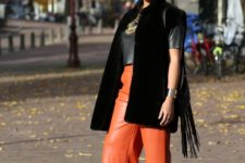 With leather shirt, black long vest and purple pumps