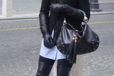 With light blue shirt, black jacket, tie, leggings, high boots and bag