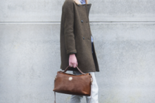 With light blue shirt, white pants, brown suede bag and olive green coat