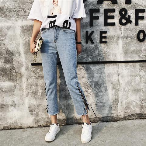 With loose printed shirt, white sneakers and clutch