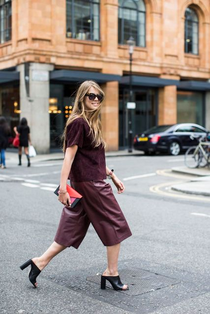 With marsala shirt, black heels and two color clutch