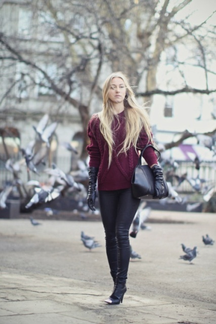 With marsala sweater, skinny pants, heeled boots and black bag
